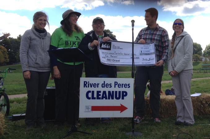 REI presents MSTWC a $5,000 check at the River des Peres Trash Bash